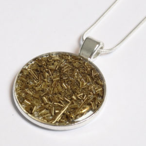 Factory Floor Jewels swarf pendant close up on white background