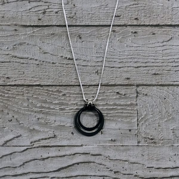 black and silver circlips pendant by factory floor jewels