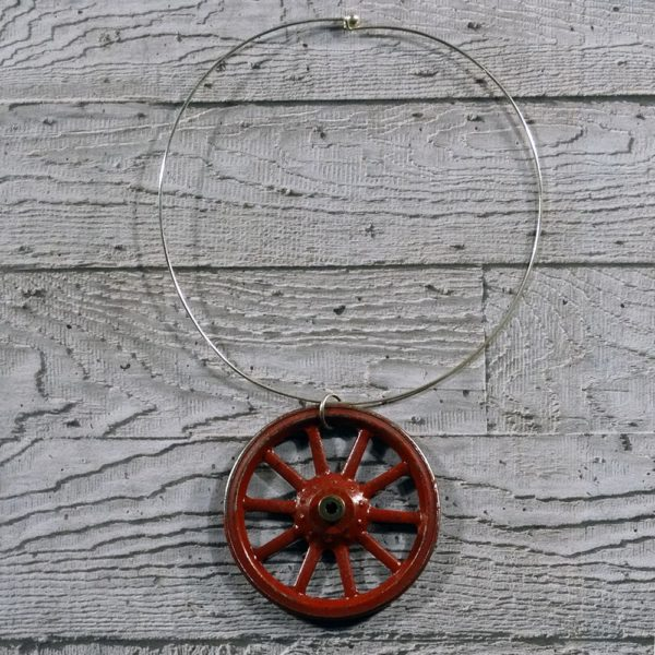 Statement Red Necklace - Red Wheel (ltd edition) by factory floor jewels concrete grey background