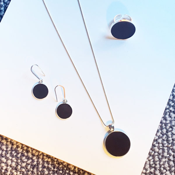 silver and black concrete ring, pendant and earrings