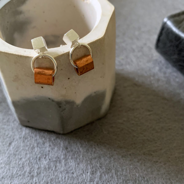 silver earrings with copper tubes
