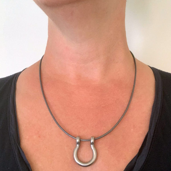 leather shackle necklace being worn