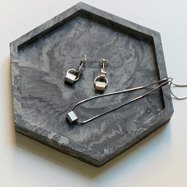 Silver cube and alu studs on a tray